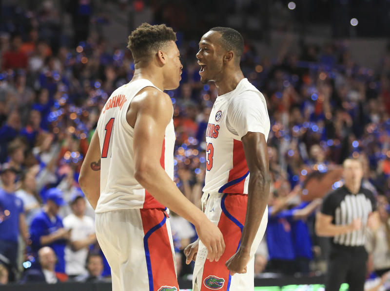 Florida forward Keyontae Johnson (11) and guard Scottie Lewis (23) celebrate after an NCAA college basketball game against Towson, Thursday, Nov. 14, 2019, in Gainesville, Fla. (AP Photo/Matt Stamey)