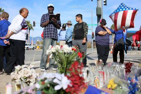Mourners gather around a makeshift memorial in honor of victims following Wednesday's attack in San Bernardino