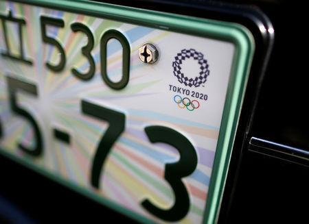 The registration plate featuring the 2020 Tokyo Olympics logo is seen on the front part of Toyota Motor Co.'s 'JPN Taxi' vehicle at the service branch of Hinomaru Kotsu Co. in Tokyo, Japan May 14, 2018. REUTERS/Issei Kato