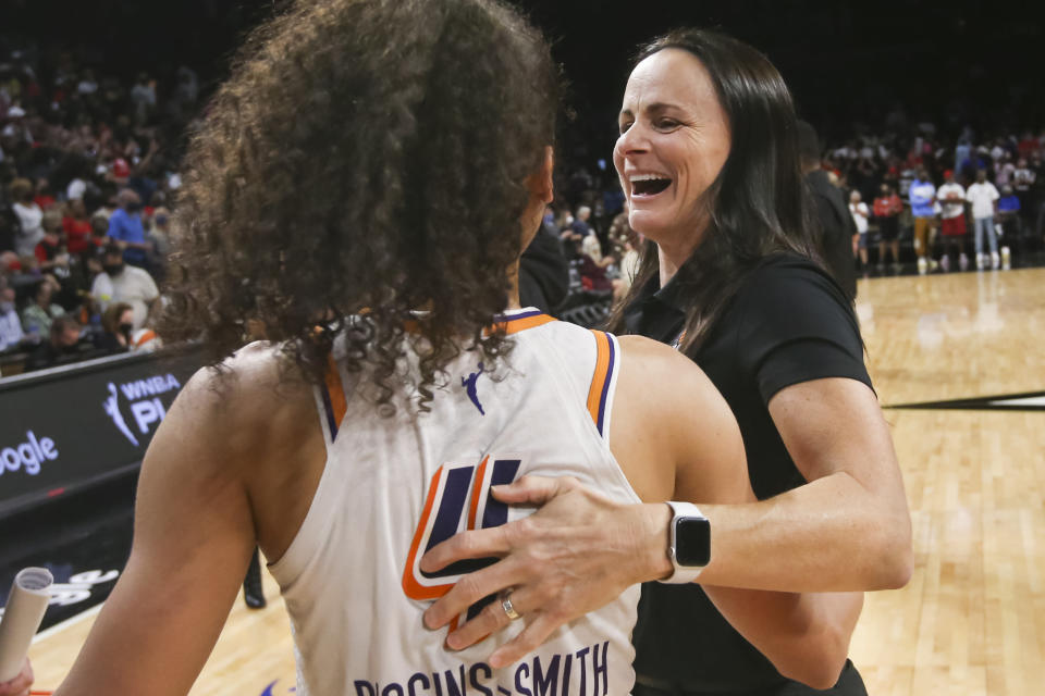 Phoenix Mercury guard Skylar Diggins-Smith (4) celebrates with coach Sandy Brondello after the Mercury defeated the Las Vegas Aces 87-84 in Game 5 of a WNBA basketball playoff series Friday, Oct. 8, 2021, in Las Vegas. (AP Photo/Chase Stevens)