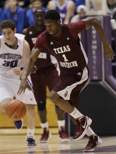 Texas Southern guard Patrick Onwenu (1) controls the ball during the first half of an NCAA college basketball game against Northwestern in Evanston, Ill., on Thursday, Dec. 15, 2011. (AP Photo/Nam Y. Huh)