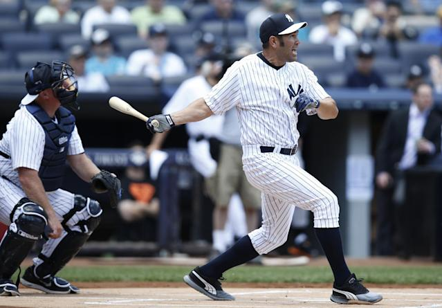 Former New York Yankees Johnny Damon hits a single during the 68th annual Old Timers Day baseball game prior to the Baltimore Orioles baseball game against the New York Yankees at Yankee Stadium in New York, Sunday, June 22, 2014. (AP Photo/Kathy Willens)