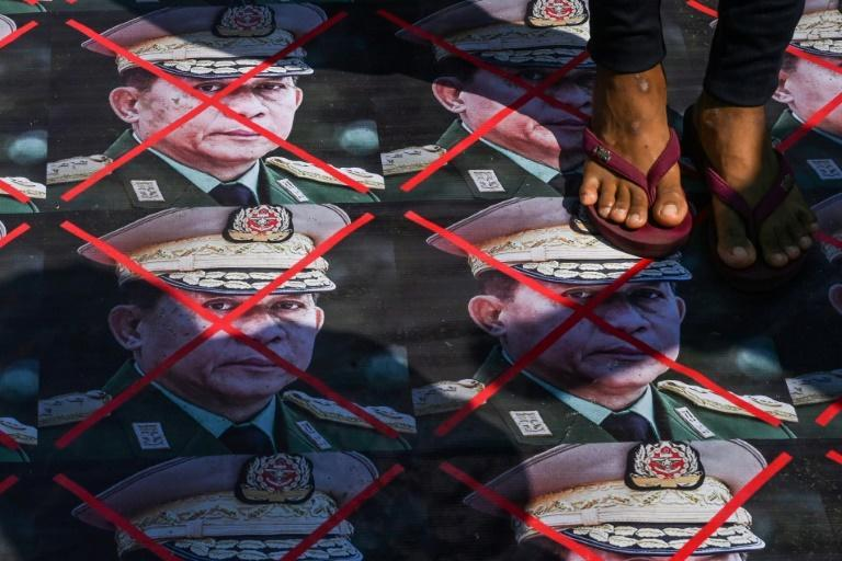 Portaits of Myanmar's junta chief Min Aung Hlaing have been plastered to the ground during demonstrations against the military's seizure of power
