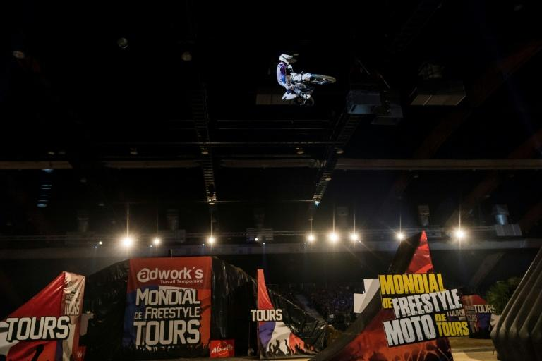 Australian rider Pat Bowden performs during a motocross freestyle show in Tours, on April 7, 2018