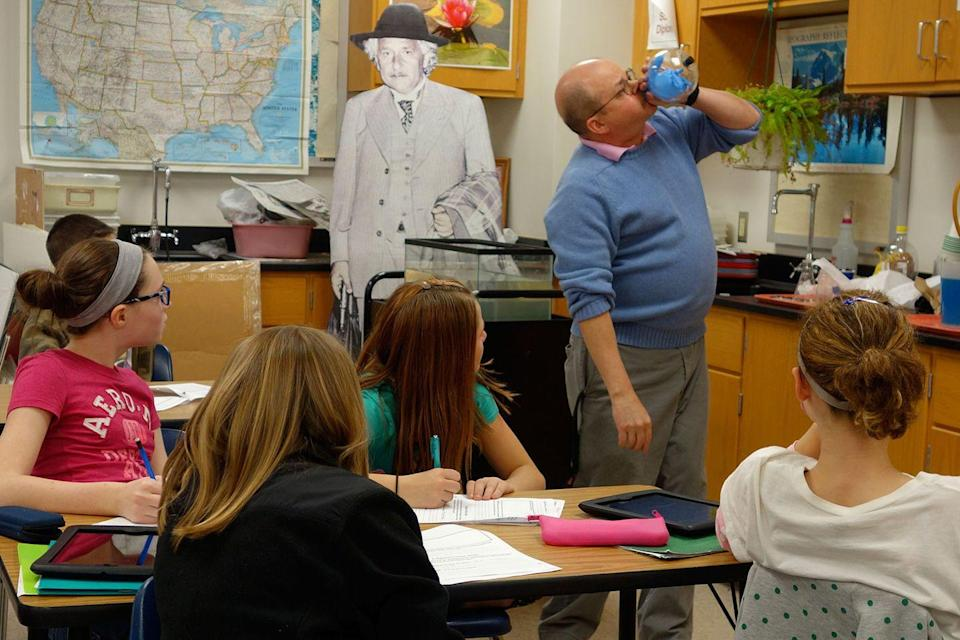 <p>A New York science teacher performs an experiment for his students. </p>