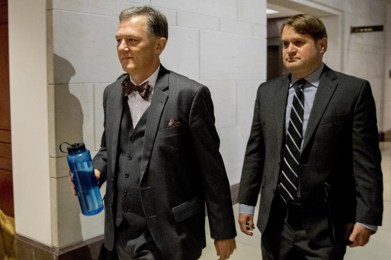 """FILE - In this Oct. 15, 2019, file photo, Deputy Assistant Secretary of State George Kent arrives on Capitol Hill in Washington. House impeachment investigators released a transcript from Kent, a career official at the State Department on Nov. 7. He testified that he was told to """"lay low"""" on Ukraine policy as the Trump administration, and the president's personal attorney Rudy Giuliani, were interacting with Ukraine outside of traditional foreign policy channels. (AP Photo/Andrew Harnik, File)"""