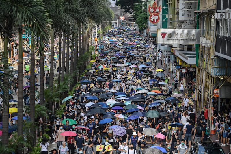 Protesters attend a pro-democracy march in Hong Kong on September 15, 2019. | NICOLAS ASFOURI—AFP/Getty Images