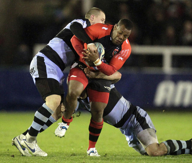 Newcastle Falcons' James Fitzpatrick (L) tackles Toulon's Stefan Armitage (R) during a pool 2, European Challenge Cup rugby union match at Kingston Park, Newcastle upon Tyne on December 8, 2011. AFP PHOTO/GRAHAM STUART (Photo credit should read GRAHAM STUART/AFP/Getty Images)