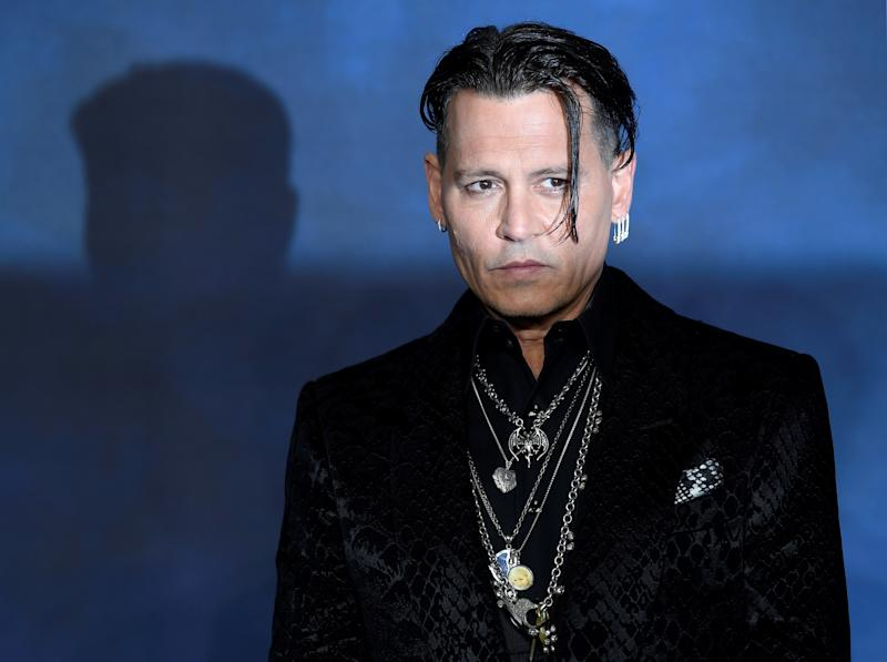 Actor Johnny Depp attends the British premiere of 'Fantastic Beasts: The Crimes of Grindelwald' movie in London, Britain, November 13, 2018. REUTERS/Toby Melville