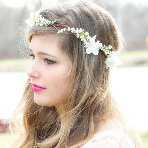 """<div class=""""caption-credit""""> Photo by: Etsy seller serenitycrystal</div><div class=""""caption-title"""">18. Bohemian Wreath</div><a rel=""""nofollow noopener"""" href=""""http://www.etsy.com/listing/97087203/ivory-cherry-blossom-hair-crown-bridal"""" target=""""_blank"""" data-ylk=""""slk:Cherry blossom hair crown"""" class=""""link rapid-noclick-resp"""">Cherry blossom hair crown</a> by Etsy seller serenitycrystal. <br> <br> <b>Related: <a rel=""""nofollow noopener"""" href=""""http://www.bridalguide.com/fashion/wedding-dress-shopping-guide/hottest-gown-trends"""" target=""""_blank"""" data-ylk=""""slk:Hottest Gown Trends this Season"""" class=""""link rapid-noclick-resp"""">Hottest Gown Trends this Season</a></b> <br>"""