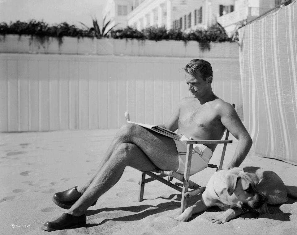 <p>Actor Douglas Fairbanks Junior lounges bare-chested on a deckchair on the beach in Los Angeles, California.<br></p><p>Other celebrity visitors this year: actress Toby Wing, Shirley Temple.</p>