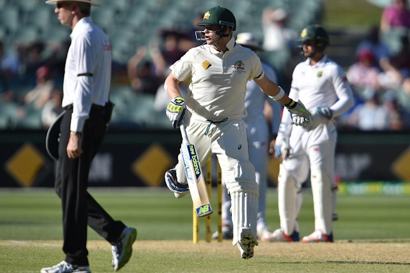 Australia's captain Steve Smith makes a run against South Africa on the fourth day of the third Test match in Adelaide (AFP Photo/Peter Parks)
