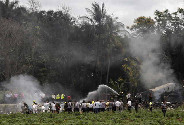 <p>Firefighters extinguish the flames that engulfed a Boeing 737 that plummeted into a yuca field with more than 100 passengers on board, in Havana, Cuba, Friday, May 18, 2018. (Photo: Enrique de la Osa/AP) </p>