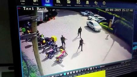 Gunmen make their way into a hotel and office complex in Nairobi, Kenya, January 15, 2019, in this still image taken from a CCTV footage obtained by Reuters TV on January 16, 2019. REUTERS/Reuters TV