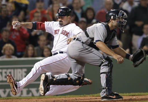 Boston Red Sox's Adrian Gonzalez slides safely into home to score on a double by David Ortiz as Detroit Tigers catcher Alex Avila waits for the throw during the fifth inning of a baseball game at Fenway Park in Boston on Tuesday, May 29, 2012. (AP Photo/Elise Amendola)
