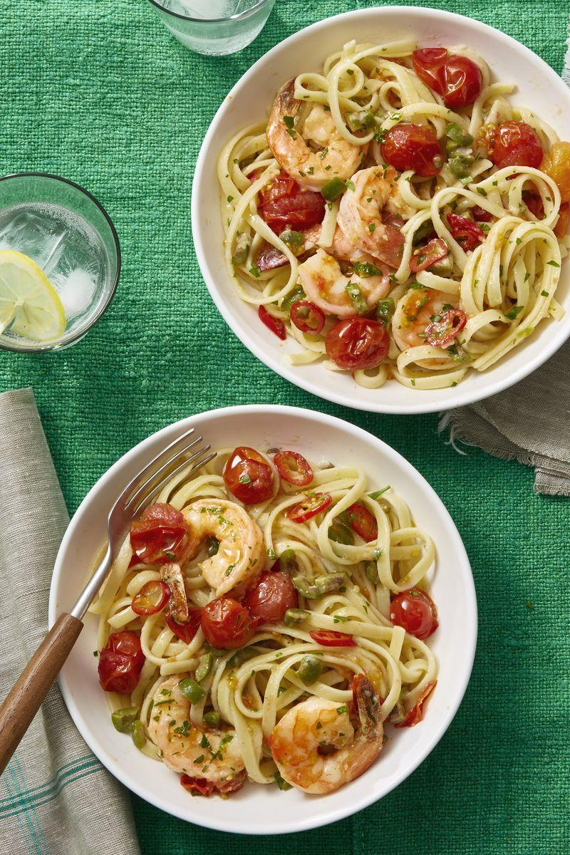 """<p>Looking for something light and refreshing? This tomato and shrimp pasta fits the bill.</p><p><em><a href=""""https://www.womansday.com/food-recipes/food-drinks/recipes/a60706/shrimp-puttanesca-recipe/"""" rel=""""nofollow noopener"""" target=""""_blank"""" data-ylk=""""slk:Get the Shrimp Puttanesca recipe."""" class=""""link rapid-noclick-resp"""">Get the Shrimp Puttanesca recipe.</a></em></p>"""