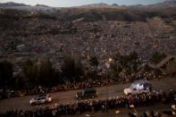FILE - In this July 8, 2015, file photo, Pope Francis rides in his popemobile, right, as he greets people lining the road from El Alto to La Paz, upon his arrival to Bolivia. Across the globe, Pope Francis' comments endorsing same-sex civil unions were received by some as encouragement for an advancing struggle and condemned by others as an earth-shaking departure from church doctrine. (AP Photo/Rodrigo Abd, File)