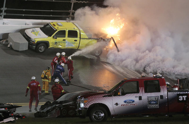 Emergency workers put out a fire on a jet dryer during the NASCAR Daytona 500 auto race at Daytona International Speedway in Daytona Beach, Fla., Monday, Feb. 27, 2012. (AP Photo/Bill Friel)