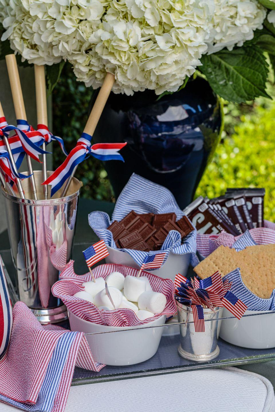 """<p><strong>What are your plans for the Fourth of July this year?</strong></p><p>We are still going up to our cabin at the lake in Sun Valley, Idaho, and will spend the long weekend there. I grew up going to my family's beach house, and we always made s'mores, so that has become a lifelong July Fourth tradition I continue with my family.</p><p><strong>What are a few of your top summer entertaining tips?</strong></p><p>Especially when it comes to Independence Day, it's important to keep the food easy to eat. I like to offer little nibbles so that all the generations can easily wander off to different parts of the gathering. </p><p>I like to align my offerings to the season. I spent a lot of summers on the coast of Maine, so I love to serve lobster rolls and other nostalgic summer foods. I mix classic with unique, like serving my popsicles infused with berries and White Claw spiked seltzer.</p><p>The minute [guests] arrive, you don't want them to worry about anything. I prep in advance so that I can do the same once the party starts. </p><p>When you're outside and have a large area to entertain in, I like to have something going on in several designated spaces. </p><p><em> Navy ginger jar, <a href=""""https://shoplohome.com/"""" rel=""""nofollow noopener"""" target=""""_blank"""" data-ylk=""""slk:Lo Home"""" class=""""link rapid-noclick-resp"""">Lo Home</a>. Lucite tray, <a href=""""https://www.markandgraham.com/"""" rel=""""nofollow noopener"""" target=""""_blank"""" data-ylk=""""slk:Mark and Graham"""" class=""""link rapid-noclick-resp"""">Mark and Graham</a>. Seersucker napkins, Dot and Army from <a href=""""https://food52.com/"""" rel=""""nofollow noopener"""" target=""""_blank"""" data-ylk=""""slk:Food52"""" class=""""link rapid-noclick-resp"""">Food52</a>. White bowls, <a href=""""https://www.crateandbarrel.com/"""" rel=""""nofollow noopener"""" target=""""_blank"""" data-ylk=""""slk:Crate and Barrel."""" class=""""link rapid-noclick-resp"""">Crate and Barrel.</a></em></p>"""