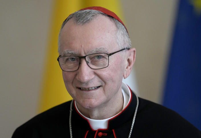 FILE - In this June 29, 2021, file photo, Vatican Secretary of State Cardinal Pietro Parolin smiles as he is welcomed by German President Frank-Walter Steinmeier for a meeting at the Bellevue palace in Berlin, Germany. The Vatican has detailed laws and rituals to ensure the transfer of power when a pope dies or resigns. Even though Pope Francis is hospitalized, he is still very much in charge. He delegates day-to-day running of the Vatican to others, including Parolin, who operate whether he is in the Apostolic Palace or not, and whether he is conscious or not. (AP Photo/Michael Sohn, File)