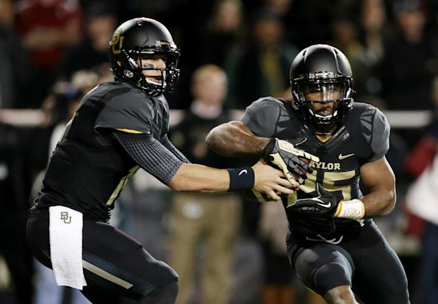 Baylor quarterback Bryce Petty fakes the hand off to Lache Seastrunk (25) in the first half of an NCAA college football game against Oklahoma, Thursday, Nov. 7, 2013, in Waco, Texas. (AP Photo/Tony Gutierrez)