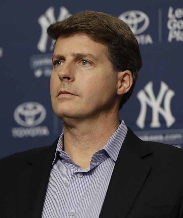 "Yankees owner Hal Steinbrenner attends a news conference at Yankee Stadium in New York, Thursday, Dec. 5, 2013. All-Star catcher Brian McCann completed his $85 million, five-year contract with the York Yankees on Tuesday in what the team called a ""significant improvement to a key position."" (AP Photo/Seth Wenig)"
