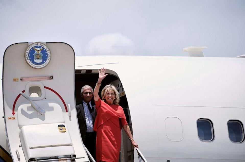 First lady Jill Biden and Dr. Anthony Fauci, director of the National Institute of Allergy and Infectious Diseases, arrive at Orlando International Airport in Orlando, Fla., Thursday June 24. - Credit: AP