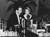 <p>Walt Disney being presented an Oscar by Shirley Temple for his famous animated feature<em> Snow White and the Seven Dwarfs</em>.</p>
