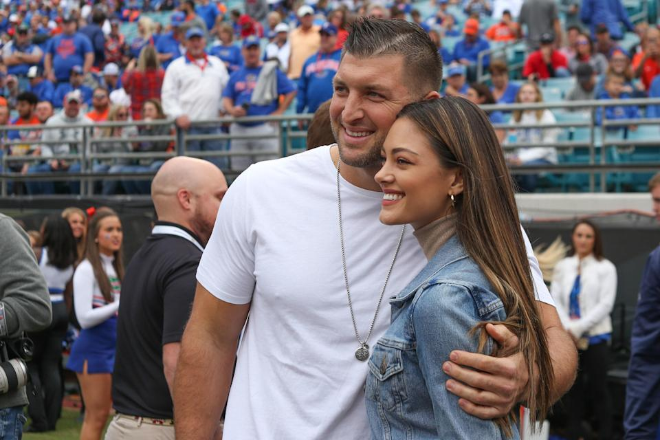 """<p>Former NFL quarterback Tim Tebow wed Demi-Leigh Nel-Peters, Miss Universe 2017, in a sunset ceremony at <a href=""""http://www.laparis.co.za/"""" rel=""""nofollow noopener"""" target=""""_blank"""" data-ylk=""""slk:La Paris Estate"""" class=""""link rapid-noclick-resp"""">La Paris Estate</a> in Cape Town, South Africa, on January 18, 2020. According to the couple, the wedding was traditional, but they each made sure to add in their own twists. """"I want the vows to be perfect,"""" Tebow <a href=""""https://people.com/sports/tim-tebow-and-demi-leigh-nel-peters-are-married-my-dreams-have-come-true/"""" rel=""""nofollow noopener"""" target=""""_blank"""" data-ylk=""""slk:told People"""" class=""""link rapid-noclick-resp"""">told <em>People</em></a> the night before the wedding. """"I'm leaving in the traditional things like 'till death do us part,' but I'm also adding some of my own things to it.""""</p> <p>Nel-Peters added, """"We're both very traditional. We wanted to look back at the wedding and see that it was intimate, elegant, and traditional. We definitely wanted it to be something that we could look back on and know that nothing was dated. We want to remember this day for the rest of our lives.""""</p> <p>For the event with 260 guests, Nel-Peters donned an elegant sleeveless custom gown by David's Bridal, <em>People</em> reports. And for their rehearsal dinner under the stars, the bride donned a beaded red jumpsuit while Tebow wore a brocade maroon suit. The ex-football star shared <a href=""""https://www.instagram.com/p/B7gJWvVg4u3/"""" rel=""""nofollow noopener"""" target=""""_blank"""" data-ylk=""""slk:stunning pictures and videos"""" class=""""link rapid-noclick-resp"""">stunning pictures and videos</a> of the dinner to his social media, captioning it, """"Blending Cultures + Traditions, Grateful.""""</p>"""