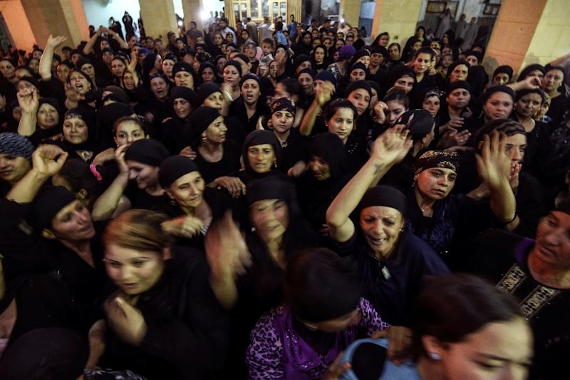 Masked gunmen attacked a bus of Coptic Christians south of the Egyptian capital, killing at least 28 people (AFP Photo/MOHAMED EL-SHAHED)