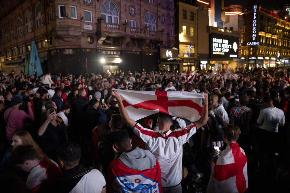 Crowd of football fans gather at Leicester Square to celebrate the victory of the England team. Hundreds of England football fans once again gathered at central London to celebrate a 4:0 win over Ukraine in the UEFA Euro 2020 taking place at Italy today. England team will now enter to the semi-final and playing against Denmark at Wembley next week. (Photo by Hesther Ng / SOPA Images/Sipa USA)