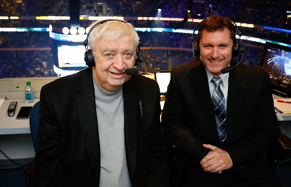 BUFFALO, NY - NOVEMBER 15: Broadcaster and cancer survivor Rick Jeanneret (L) returns alongside Dan Dunleavy (R) to broadcast a portion of the game between the Buffalo Sabres and the Toronto Maple Leafs on November 15, 2014 at the First Niagara Center in Buffalo, New York.  (Photo by Bill Wippert/NHLI via Getty Images)