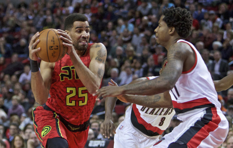 FILE - In this Jan. 20, 2016 file photo, Atlanta Hawks forward Thabo Sefolosha, left, drives on Portland Trail Blazers center Ed Davis during the first half of an NBA basketball game in Portland, Ore. On Thursday, April 6, 2017, New York City settled a wrongful arrest lawsuit for $4 million that Sefolosha filed against the city after police officers broke his leg while arresting him outside a Manhattan nightclub in 2015. That amount is more than the city has paid out in some of its most notorious police brutality cases. (AP Photo/Craig Mitchelldyer, File)