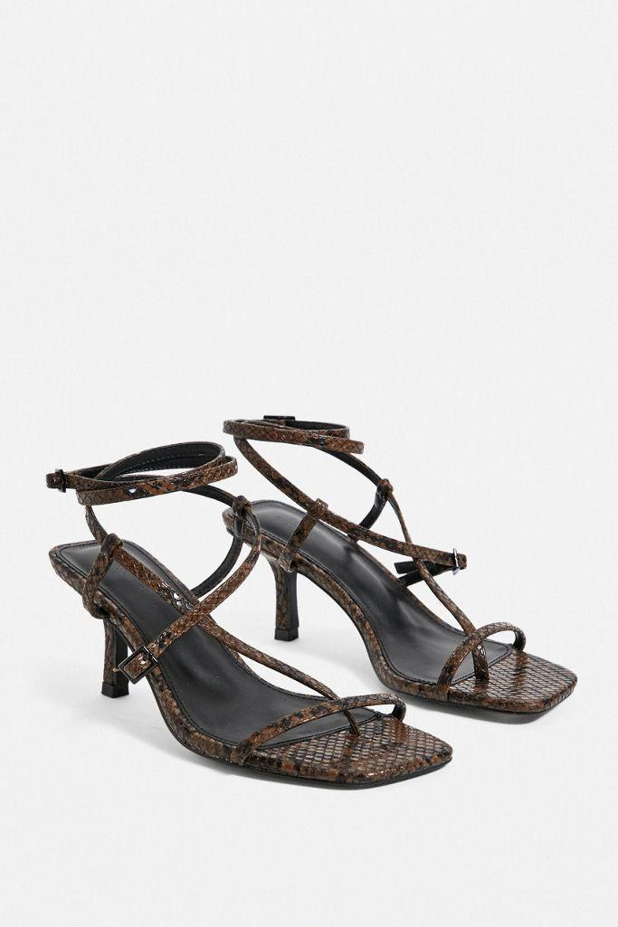 "$59, Urban Outfitters. <a href=""https://www.urbanoutfitters.com/shop/uo-shay-strappy-sandals?"" rel=""nofollow noopener"" target=""_blank"" data-ylk=""slk:Get it now!"" class=""link rapid-noclick-resp"">Get it now!</a>"