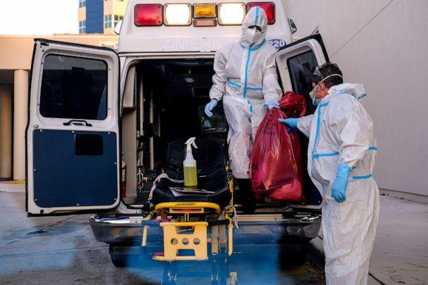 PHOTO: EMTs cleanse their materials outside Memorial West Hospital where coronavirus (COVID-19) patients are treated, in Pembroke Pines, Fla., July 13, 2020. (Maria Alejandra Cardona/Reuters)