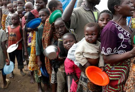 Internally displaced people wait for food distribution at an internally displaced persons (IDP) camp in Bunia