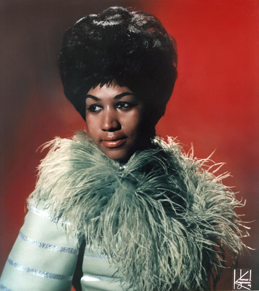 <p>Aretha Franklin wears a turquoise feather trim coat with super-teased locks and dewy skin. (Photo by Michael Ochs Archives/Getty Images) </p>