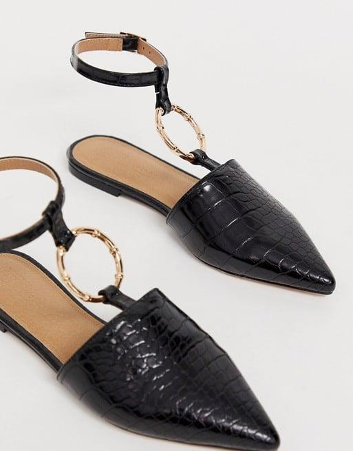 "<p>Match your jewelry to the gold hardware on these <a href=""https://www.popsugar.com/buy/ASOS-Design-Likeable-Ballet-Flats-477116?p_name=ASOS%20Design%20Likeable%20Ballet%20Flats&retailer=us.asos.com&pid=477116&price=35&evar1=fab%3Aus&evar9=46084750&evar98=https%3A%2F%2Fwww.popsugar.com%2Fphoto-gallery%2F46084750%2Fimage%2F46684416%2FASOS-Design-Likeable-Ballet-Flats&list1=fall%20fashion%2Cshoes%2Cfall%2Cspring%2Csummer%2Cshoppping%2Cspring%20fashion%2Csummer%20fashion%2Caffordable%20shopping&prop13=api&pdata=1"" rel=""nofollow"" data-shoppable-link=""1"" target=""_blank"" class=""ga-track"" data-ga-category=""Related"" data-ga-label=""https://us.asos.com/asos-design/asos-design-likeable-ballet-flats-with-bamboo-ring/prd/11068214?clr=black-croc&amp;colourWayId=16325565&amp;SearchQuery=&amp;cid=6459"" data-ga-action=""In-Line Links"">ASOS Design Likeable Ballet Flats</a> ($35).</p>"