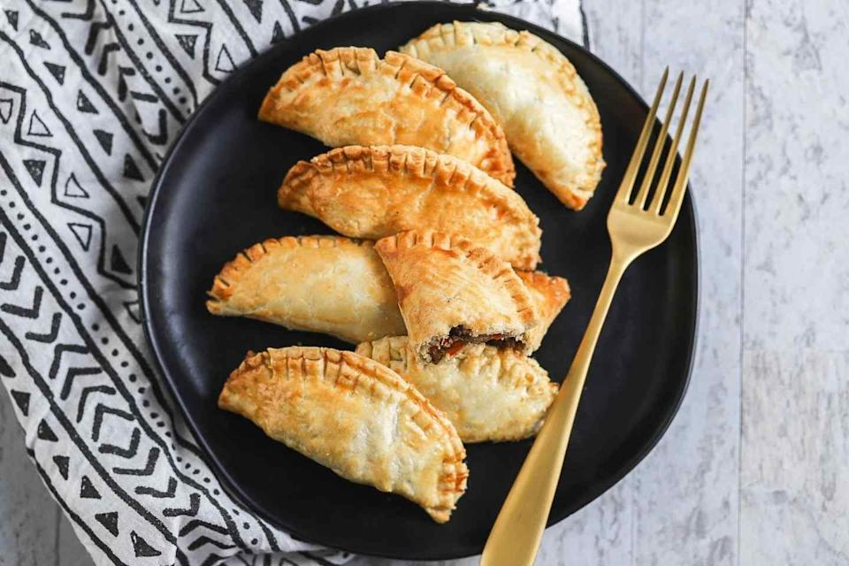 """<p>These air fryer beef empanadas are easier to make than they sound. Just wrap a puff pastry around seasoned ground beef, and toss 'em in the air fryer. You'll get mouthwatering results that everyone will enjoy.</p> <p><strong>Get the recipe</strong>: <a href=""""https://cookswithsoul.com/air-fryer-beef-empanadas/"""" class=""""link rapid-noclick-resp"""" rel=""""nofollow noopener"""" target=""""_blank"""" data-ylk=""""slk:air fryer beef empanadas"""">air fryer beef empanadas</a></p>"""