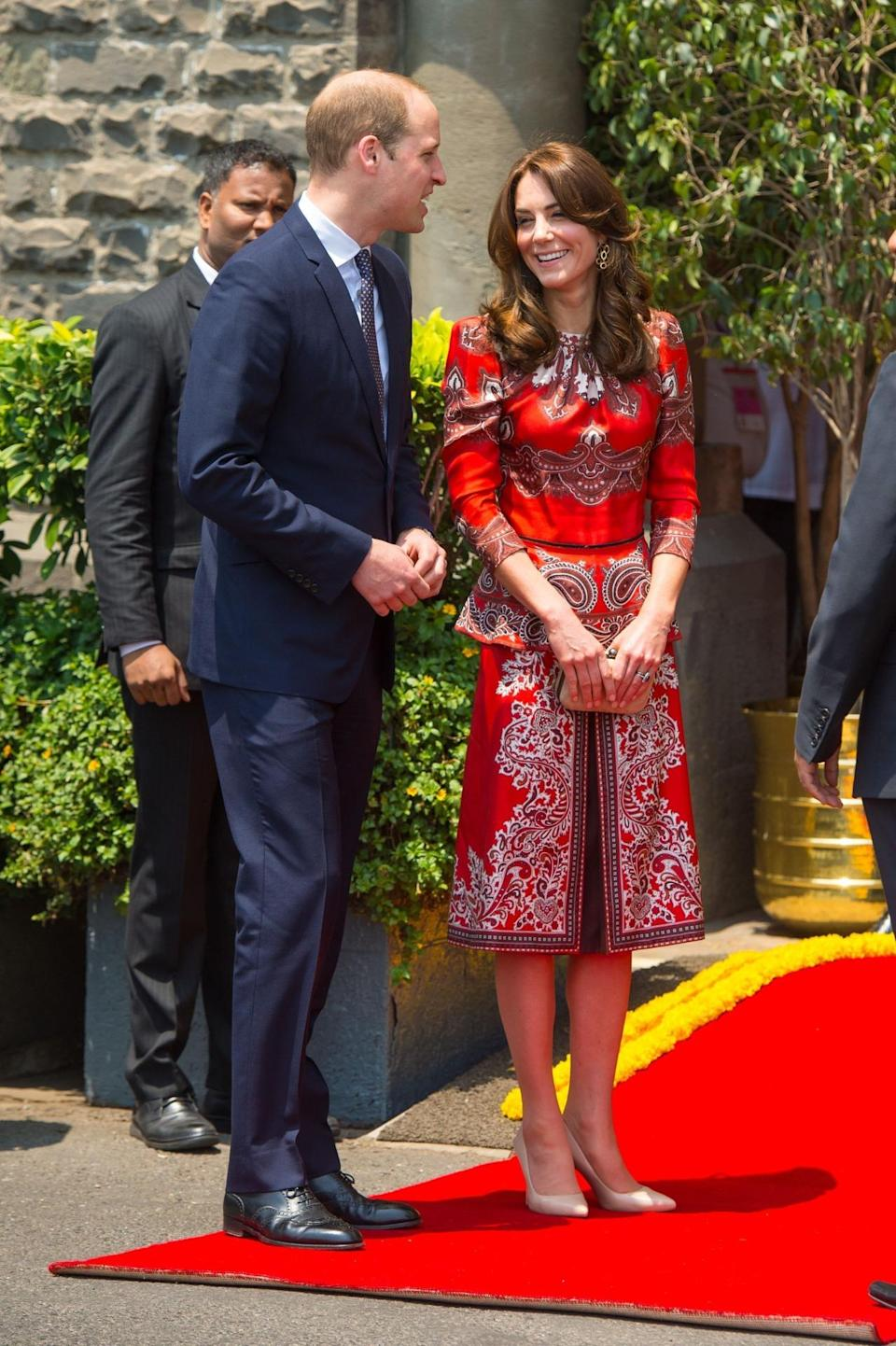 <p>For the launch of the royal tour to India, Kate chose a bespoke Alexander McQueen suit featuring a peplum top and oriental print. L.K. Bennett heels and a suede clutch by Russell and Bromley complemented the ensemble. </p><p><i>[Photo: PA]</i></p>