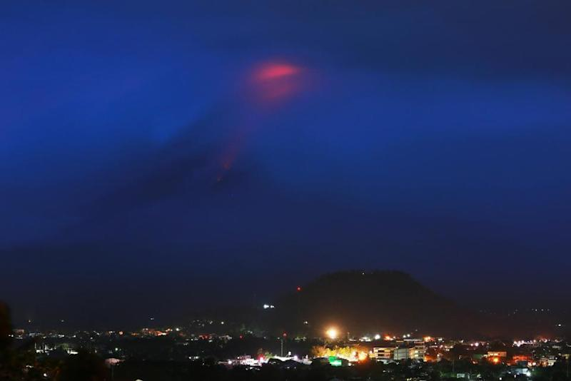 Mayon Volcano 'fireworks' draw tourists as residents flee