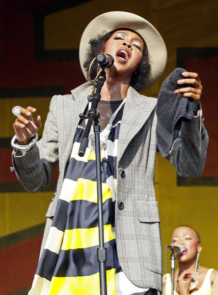 FILE - In this May 7, 2011 file photo, Lauryn Hill performs at theNew Orleans Jazz and Heritage Festival in New Orleans. Federal prosecutors have charged five-time Grammy winner Lauryn Hill with willfully failing to file income tax returns with the IRS. Authorities say Hill earned more than $1.6 million during the three years that she failed to file returns. Prosecutors say her primary source of income is royalties from the recording and film industries. The 37-year-old South Orange, N.J., resident is scheduled to appear before a federal magistrate on June 29. (AP Photo/Patrick Semansky, file)