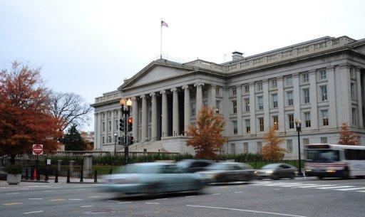 <p>Vehicles drive by the US Treasury Building in Washington on November 15, 2011. Treasury Secretary Timothy Geithner has warned the nation will reach its $16.39 trillion debt limit on December 31.</p>