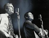 """<p>Simon and Garfunkel created striking harmonies together, while their hauntingly beautiful lyrics defined the tumultuous '60s. The duo had already enjoyed great success with songs such as <a href=""""https://www.amazon.com/Scarborough-Fair-Canticle/dp/B07RV53M2F/?tag=syn-yahoo-20&ascsubtag=%5Bartid%7C10063.g.35225069%5Bsrc%7Cyahoo-us"""" rel=""""nofollow noopener"""" target=""""_blank"""" data-ylk=""""slk:&quot;Scarborough Fair&quot;"""" class=""""link rapid-noclick-resp"""">""""Scarborough Fair""""</a>(1966), <a href=""""https://www.amazon.com/Parsley-Rosemary-Thyme-Simon-Garfunkel/dp/B0054YH5LY/?tag=syn-yahoo-20&ascsubtag=%5Bartid%7C10063.g.35225069%5Bsrc%7Cyahoo-us"""" rel=""""nofollow noopener"""" target=""""_blank"""" data-ylk=""""slk:&quot;Parsley, Sage, Rosemary and Thyme&quot;"""" class=""""link rapid-noclick-resp"""">""""Parsley, Sage, Rosemary and Thyme""""</a> (1966), and <a href=""""https://www.amazon.com/Sounds-Silence-Simon-Garfunkel/dp/B0018PXEI6/?tag=syn-yahoo-20&ascsubtag=%5Bartid%7C10063.g.35225069%5Bsrc%7Cyahoo-us"""" rel=""""nofollow noopener"""" target=""""_blank"""" data-ylk=""""slk:&quot;Sounds of Silence&quot;"""" class=""""link rapid-noclick-resp"""">""""Sounds of Silence""""</a> (1967). But they were introduced to a wider audience when their music was featured in the 1967 film, <u>The Graduate</u>, including songs such as <a href=""""https://www.amazon.com/Mrs-Robinson-Single-Mix/dp/B07RQVY25V/?tag=syn-yahoo-20&ascsubtag=%5Bartid%7C10063.g.35225069%5Bsrc%7Cyahoo-us"""" rel=""""nofollow noopener"""" target=""""_blank"""" data-ylk=""""slk:&quot;Mrs. Robinson&quot;"""" class=""""link rapid-noclick-resp"""">""""Mrs. Robinson""""</a>.</p>"""