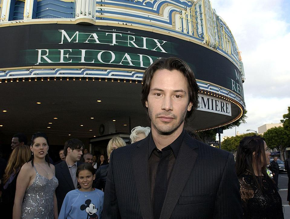 """Keanu Reeves arrives at """"The Matrix Reloaded"""" premiere on May 7, 2003, at the Mann Village Theater in L.A. (Photo: L. Cohen/WireImage)"""
