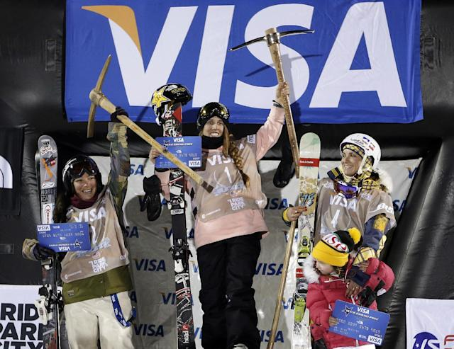 From left, third-place finisher Anais Caradeux, of France; first-place Maddie Bowman, of the United States; and second-place Marie Martinod, of France, with her daughter Melirose, 4, as they celebrate on the podium following the women's U.S. Grand Prix freestyle halfpipe skiing event Friday, Jan. 17, 2014, in Park City, Utah. (AP Photo/Rick Bowmer)