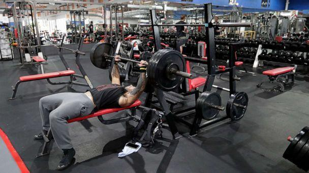 PHOTO: Daniel Bolling works out at the Downtown Gym, May 18, 2020, in Orlando, Fla. (John Raoux/AP, FILE)