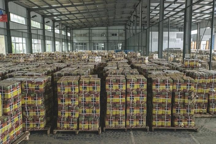 """Boxes of soaked tea unfit for sale await disposal at the factory in Shexian. <span class=""""copyright"""">(Liu Bowen / For The Times)</span>"""