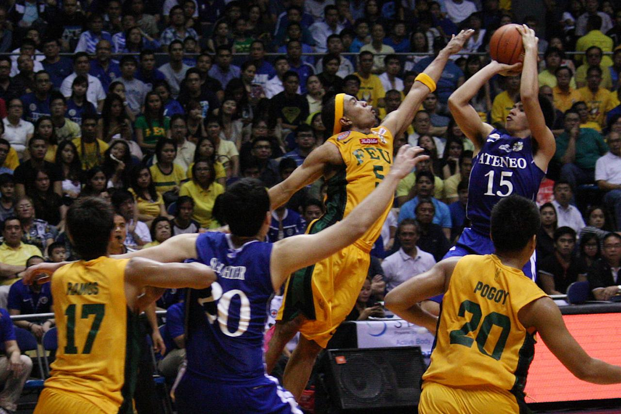 Kiefer Ravena of Ateneo Blue Eagles goes for the basket against FEU Tamaraws during the UAAP Season 74 first game of the best-of-three championship series held at Smart Araneta Coliseum in Quezon City. (Marlo Cueto/NPPA Images)