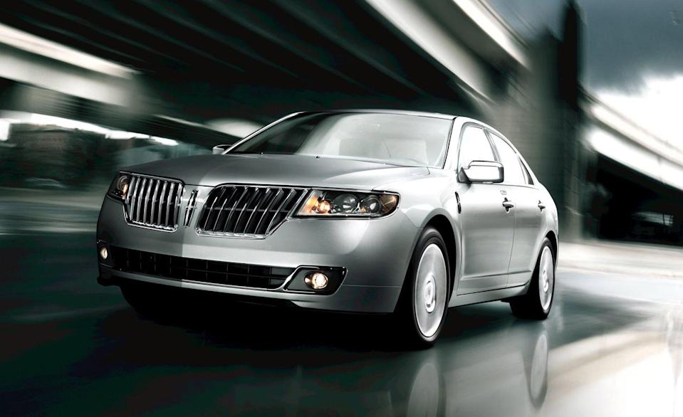 """<p>Despite its luxury nameplate, the <a href=""""https://www.caranddriver.com/lincoln/mkz"""" rel=""""nofollow noopener"""" target=""""_blank"""" data-ylk=""""slk:Lincoln MKZ"""" class=""""link rapid-noclick-resp"""">Lincoln MKZ</a> is one of the most affordable sedans on this list. You can pick up one of these leather-lined four-doors for about $6000. Basically a dolled-up version of the <a href=""""https://www.caranddriver.com/ford/fusion"""" rel=""""nofollow noopener"""" target=""""_blank"""" data-ylk=""""slk:Ford Fusion"""" class=""""link rapid-noclick-resp"""">Ford Fusion</a>, the MKZ has never been one of our favorite sedans, but its popularity has kept it around for two generations. The first was sold from 2006 to 2012, and its final two years of production offer a good blend of safety, reliability, and a low, low price. Two versions were offered, the MKZ, which was powered by a big 3.5-liter V-6, and the MKZ Hybrid, which paired a four-cylinder engine with a small electric motor and battery pack. The V-6 cars are quick, hitting 60 mph in less than seven seconds, but the Hybrid was packed with standard features and gets much better mileage. It was EPA rated for 41 mpg in the city and 36 on the highway. </p>"""